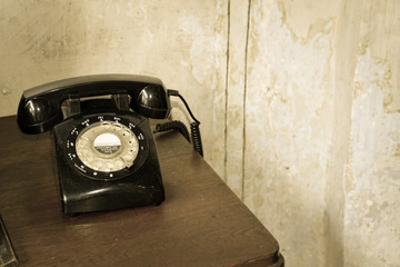 Vintage telephone on wooden table