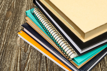 folded stack of workbooks.