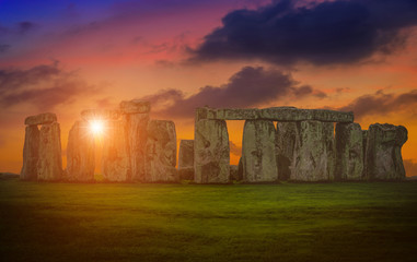 Wall Mural - Landscapes image of sunset over Stonehenge an ancient prehistoric stone monument, Wiltshire, UK.