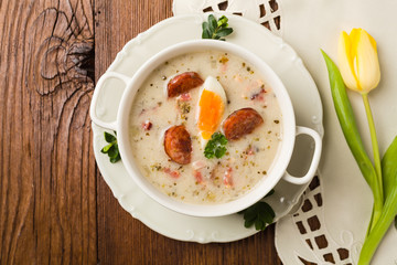 Traditional Polish white borsch with Easter decoration