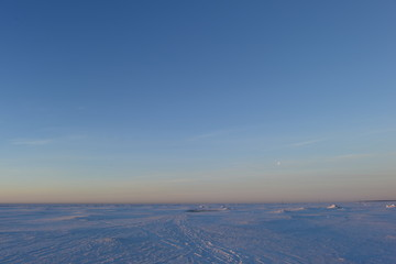 White snow desert of the Gulf of Finland morning before dawn