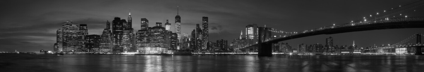 Spoed Foto op Canvas New York New York city with Brooklyn Bridge, iconic skyline panorama at night in black and white