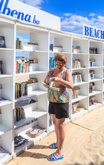 Woman near free beach library opened  at the Black Sea resort of Albena. Bulgaria
