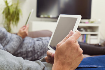 man and woman using electronic devices