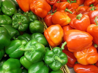 Pile of Vivid Green and Orange Color Ripe Bell-pepper with Stems