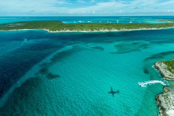 Airplane shadow over sea, Exhuma Chain, Staniel Cay, Bahamas, Caribbean