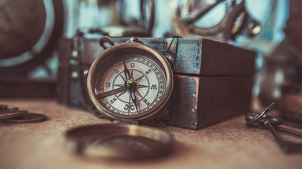 Antique compass and treasure box in vintage style picture.