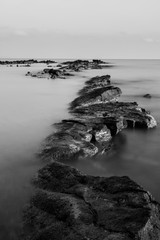 Black and white rocks in long exposure.