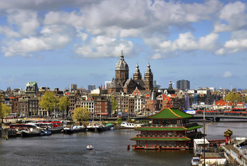 Beautiful morning spring view of old town in Amsterdam and  Amstel river