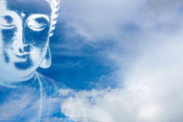 Buddha image in the blue sky with clouds