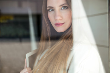Portrait of a businesswoman with a glass reflection