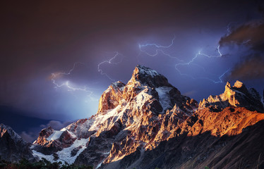 Fantastic collage. Beautiful lightning over the snow-capped