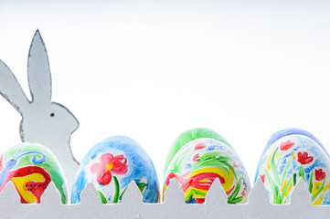 Easter composition with colorful Easter eggs and rabbit