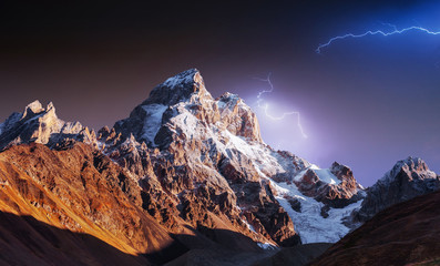 Fantastic collage. Beautiful lightning over the snow-capped moun