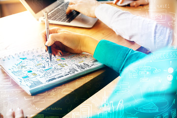 Businesswoman drawing business charts