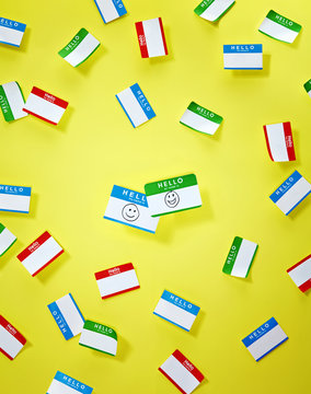 Red green and blue 'hello' stickers on yellow background