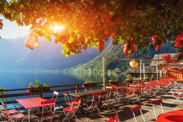 Summer cafe on the beautiful lake between mountains. Alps. Halls