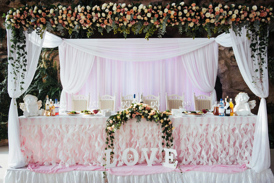 luxurious decorated table in the main hall wedding