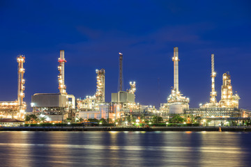 Oil refinery on water front at twilight