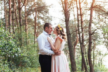 Happy couple in a pine forest Beauty world