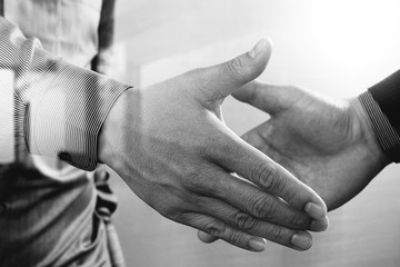 Business partnership meeting concept.photo businessmans handshake. Successful businessmen handshaking after perfect deal.close up,black and white