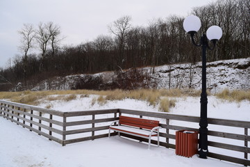 the lantern on the boardwalk in the winter in nature
