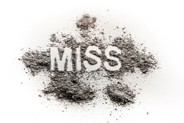 The word miss written in dirt, dust, ash as pageant, contest, girl, missing, lost person, grief, sorrow, paradox, fail, ugly, concept background