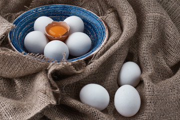 fresh eggs collected in the plate for cooking on the fabric.