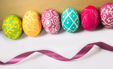 Closeup of beautiful Easter eggs with their hands. A festive mood.