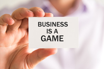 Businessman with BUSINESS IS A GAME card