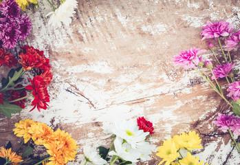 Wall Mural - Colorful flowers bouquet on vintage wooden background, border design. vintage color tone