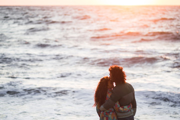 Couple in love on the beach at sunset. Romantic moments together