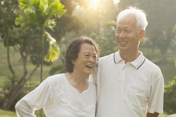 Asian seniors couple at outdoor park