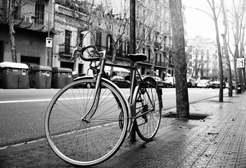 Old vintage style bicycle parking with locked by a big chain and key