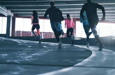 Sporty people running. Wall mural