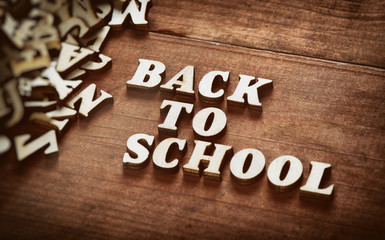 word Back to School on wooden background