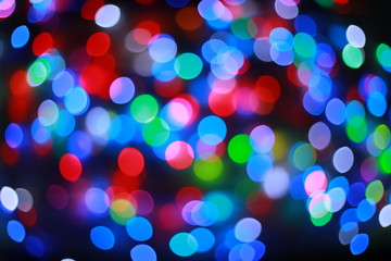 Color Blurred background : Bokeh lighting in concert with audience , texture dot copy space,music performance concert with bokeh spotlight. entertainment concert lighting on stage,blurred disco party.