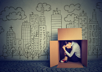 woman hiding in the box on skyscraper city background