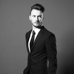 Handsome stylish man in elegant suit