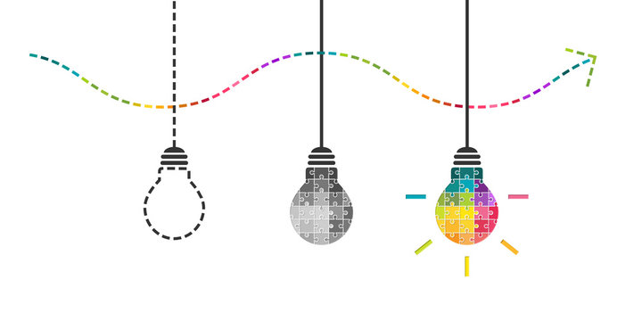 Thinking, perseverance and success concept with light bulb made of colorful puzzle pieces