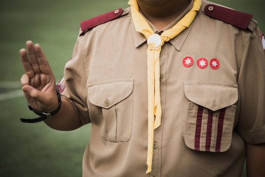 Asian boy scout oath explained in camp activities as part of the study.