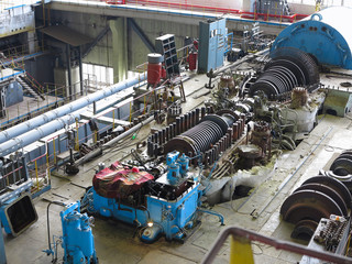 steam turbine in repair process, machinery, pipes, tubes, at power plant