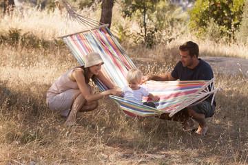 Croatia, Dalmatia, Parents playing with child in hammock