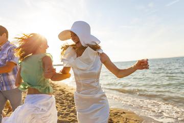 Bride and girlfriend dancing on the beach, Dalmatia, Croatia