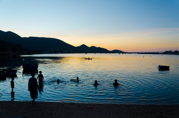 the silhouettes of villagers in early morning at Nai lagoon, Ninh Thuan