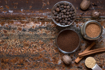 Warm spices on rusty metal background