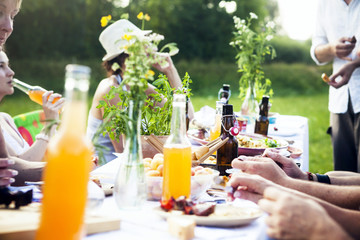 Friends barbecuing on the riverside, picnic table in foreground, Bavaria, Germany