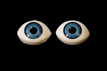 Detached Dolly Eyes With Blue Iris on Black Background
