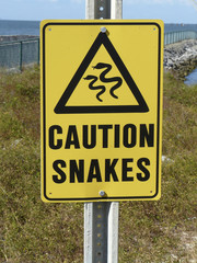 Caution Sign Snakes at Mobile Ferry