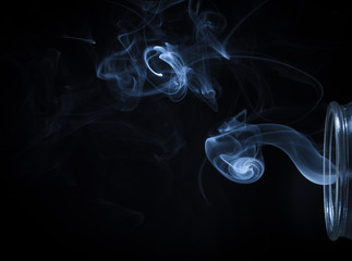 Abstract Blue Smoke Flowing From Bottle Background